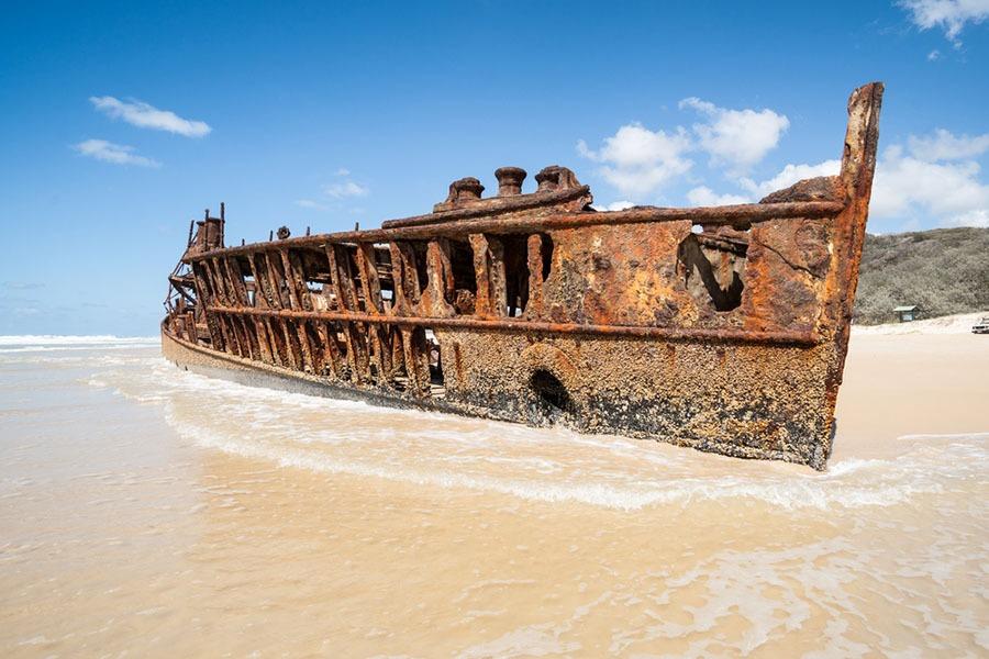 beach rental tin can bay shipwreck on beach
